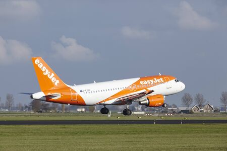 The Easyjet Airbus A319-111 with identification G-EZDU lands at Amsterdam Airport Schiphol (The Netherlands, AMS), Polderbaan on April 8, 2016.