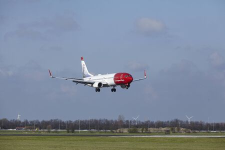 The Norwegian (Anton K.H. Jakobsen Livery) Boeing 737-8IP with identification  LN-NGT lands at Amsterdam Airport Schiphol (The Netherlands, AMS), Polderbaan on April 8, 2016.