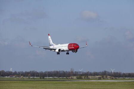 polderbaan: The Norwegian (Anton K.H. Jakobsen Livery) Boeing 737-8IP with identification  LN-NGT lands at Amsterdam Airport Schiphol (The Netherlands, AMS), Polderbaan on April 8, 2016.