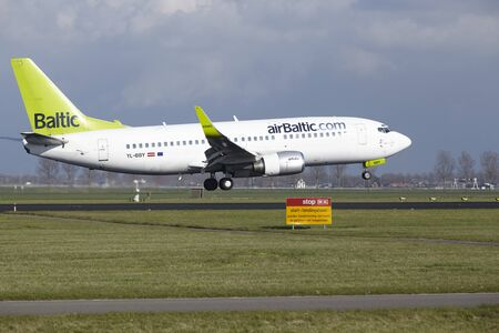 The Air Baltic Boeing 737-36Q with identification YL-BBY lands at Amsterdam Airport Schiphol (The Netherlands, AMS), Polderbaan on April 8, 2016.