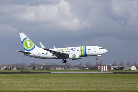The Transavia Boeing 737-7K2 with identification PH-XRA lands at Amsterdam Airport Schiphol (The Netherlands, AMS), Polderbaan on April 8, 2016. Editorial