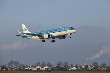 The KLM Cityhopper Embraer ERJ-190STD with identification PH-EZW lands at Amsterdam Airport Schiphol (The Netherlands, AMS), Polderbaan on April 8, 2016.