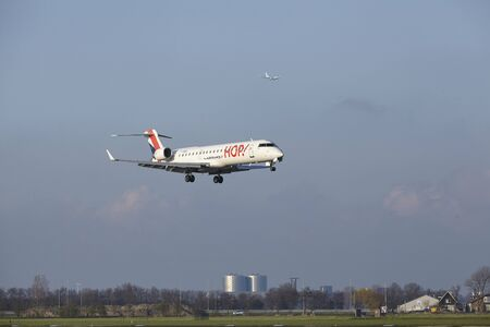 The HOP! Bombardier CRJ-701 with identification F-GRZG lands at Amsterdam Airport Schiphol (The Netherlands, AMS), Polderbaan on April 8, 2016.