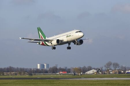 The Allitalia Airbus A319-112 with identification EI-IMF lands at Amsterdam Airport Schiphol (The Netherlands, AMS), Polderbaan on April 8, 2016.