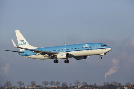 alight: The KLM Boeing 737-8K2 with identification PH-BXC lands at Amsterdam Airport Schiphol (The Netherlands, AMS), Polderbaan on April 8, 2016.