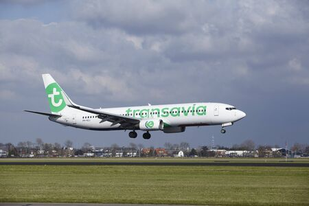 The Transavia Boeing 737-8K2 with identification PH-HZJ lands at Amsterdam Airport Schiphol (The Netherlands, AMS), Polderbaan on April 8, 2016.