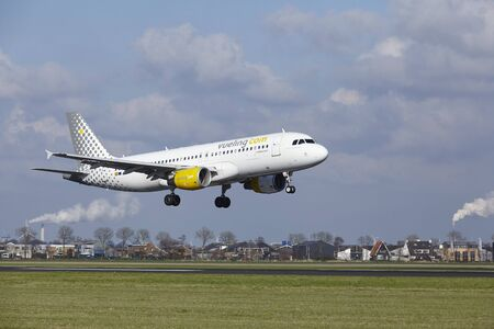 The Vueling Airbus A320-214 with identification EC-LOP lands at Amsterdam Airport Schiphol (The Netherlands, AMS), Polderbaan on April 8, 2016.