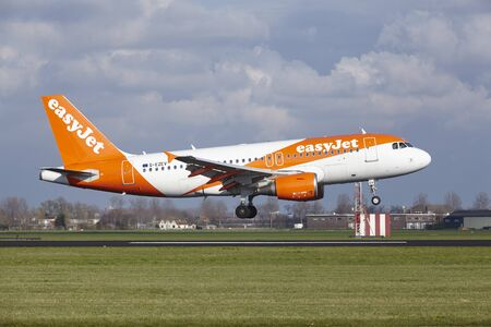 The Easyjet Airbus A319-111 with identification G-EZEV lands at Amsterdam Airport Schiphol (The Netherlands, AMS), Polderbaan on April 8, 2016.