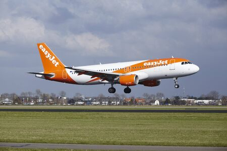 The Easyjet Airbus A320-214 with identification G-EZTH lands at Amsterdam Airport Schiphol (The Netherlands, AMS), Polderbaan on April 8, 2016.