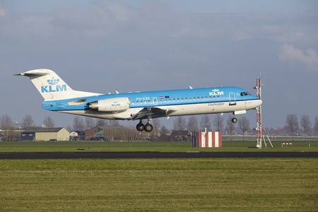 The KLM Cityhopper Fokker 70 with identification PH-KZK lands at Amsterdam Airport Schiphol (The Netherlands, AMS), Polderbaan on April 8, 2016.