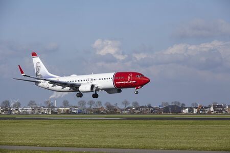 alight: The Norwegian (Anton K.H. Jakobsen Livery) Boeing 737-8IP with identification  LN-NGT lands at Amsterdam Airport Schiphol (The Netherlands, AMS), Polderbaan on April 8, 2016.