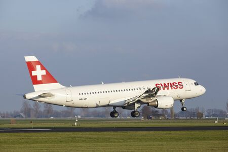 The SWISS Airbus A320-214 with identification HB-IJR lands at Amsterdam Airport Schiphol (The Netherlands, AMS), Polderbaan on April 8, 2016. Editorial