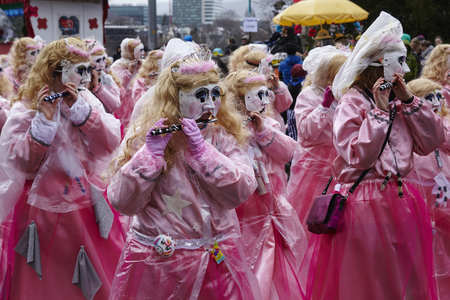 rite: Some fully costumed carnival activists walk through the city during the carnival procession (cortege) of the Carnivel at Basel 2017 (Basle - Switzerland) on March 6, 2017. Editorial