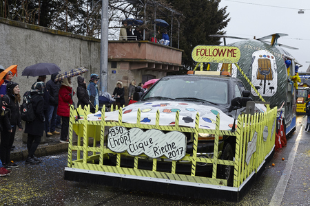 A carnival waggon drives through the city during the carnival procession (cortege) of the Carnivel at Basel 2017 (Basle - Switzerland) on March 6, 2017.