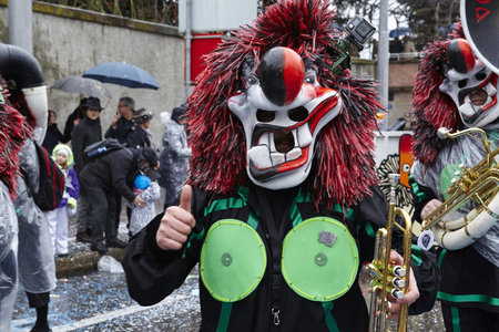 A fully costumed carnival activist walks through the city during the carnival procession (cortege) of the Carnivel at Basel 2017 (Basle - Switzerland) on March 6, 2017.