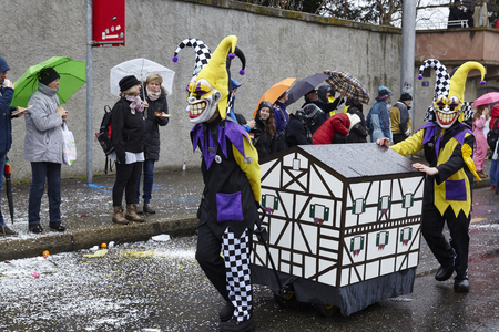 Some fully costumed carnival activists walk through the city during the carnival procession (cortege) of the Carnivel at Basel 2017 (Basle - Switzerland) on March 6, 2017. Editorial