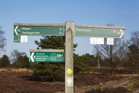 26: A guidepost in the Luneburg Heath near Schneverdingen (Lower Saxony, Germany) shows the direction to Hoepen, Heidegarten (Heath garden), Silvestersee, Wilseder Berg (Wilsede Mountain) and Pietzmoor on March 2017, 26.