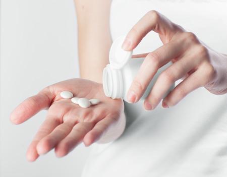 antidepressant: hand holding white pills