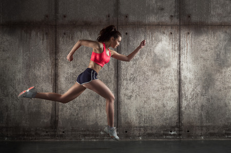 fast: photo of caucasian adult girl - runner Stock Photo