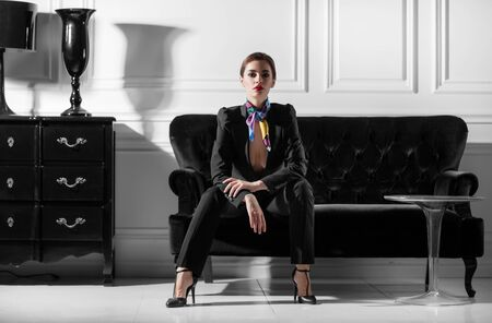 photo of fashionable business lady in black and white interior Stock fotó