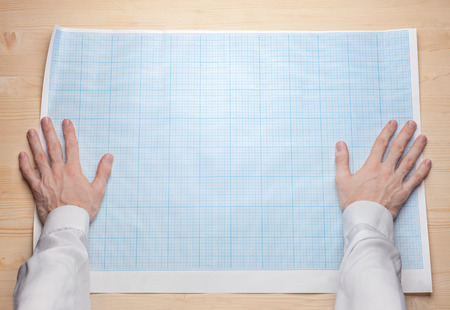 two man hands holding empty blueprint canvas