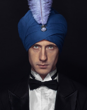 conjuror: low key portrait of magician in turban Stock Photo