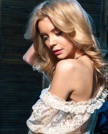 nightie: photo of young attractive blonde caucasian woman in nightie, staying in dark bedroom