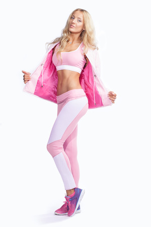 yoga pants: fitness woman dressed in pink sportswear isolated on white background Stock Photo