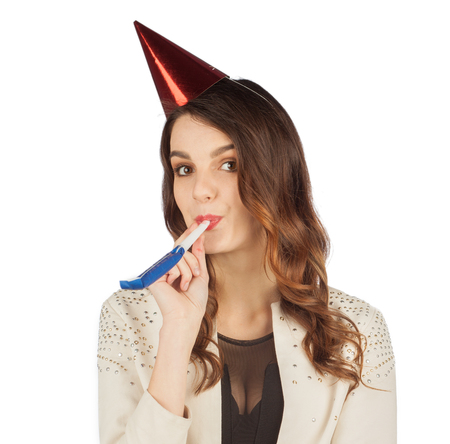 young woman in celebratory cap celebrates her birthday isolated on white background