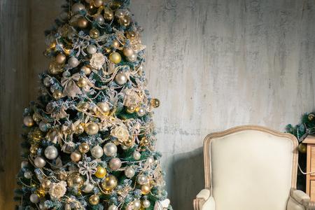empty chair near christmas tree, interior, nobody Stock Photo