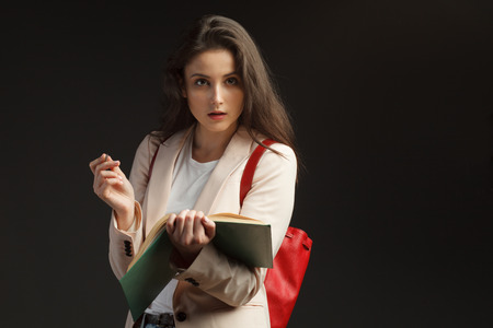 young attractive female journalist interviews on black background Stock Photo - 87520875