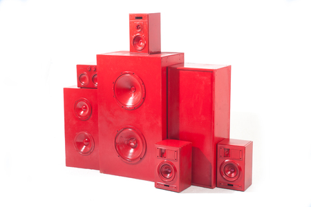 many different red music loudspeakers isolated on white background