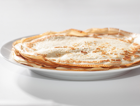 thin pancakes on white dish isolated on white background, selective focus