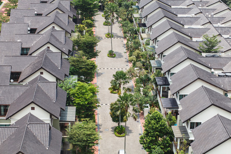 safe neighborhood suburban homes with green trees and palms Stock Photo