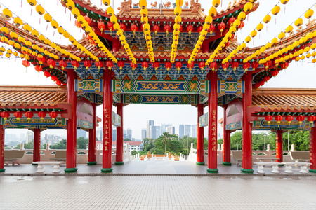 Thean Hou Temple gates, and skyscreapers skyline in Kuala Lumpur