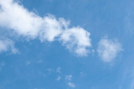 blue sky with one long cloud, full-frame texture Stock Photo