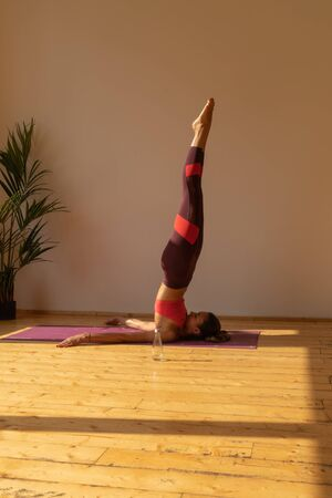 sporty girl doing yoga exercise at home Stock fotó