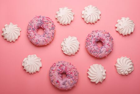 many marshmallows with donuts isolated on pink background