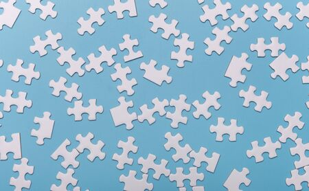 white blank puzzle parts pattern isolated on blue background