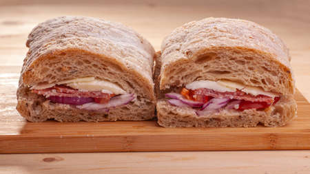 panini delicious sandwich with red onion, ham, and cheese on wooden table, 版權商用圖片
