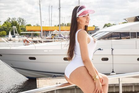 undergarments: Beautiful girl in swimsuit posing on a boat, Wharf, Marina, beach Stock Photo
