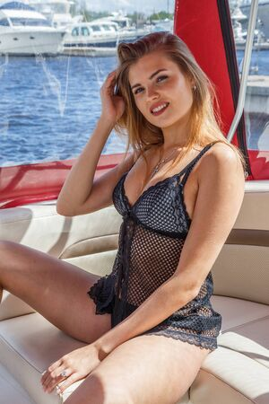 1 person: Beautiful blond woman in swimsuit, underwear posing at the port near the yacht, on the yacht