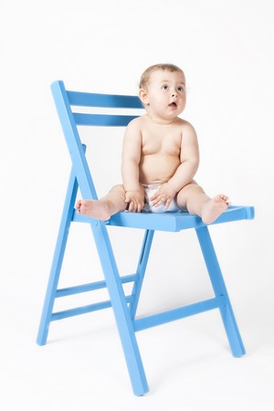 Baby on a blue chair photo