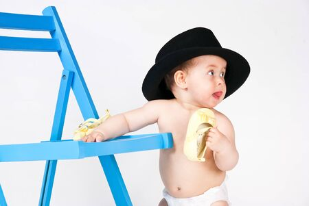Baby with a black hat photo
