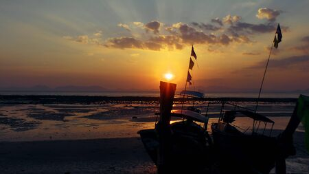 Sunset with longtail boat