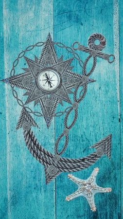 Compass and anchor on old wood