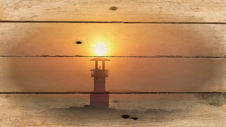 Lighthouse in the sunset Stock Photo