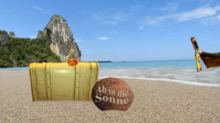 Suitcase on the beach in Thailand