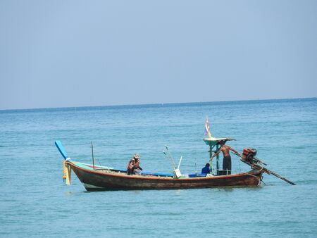 Fishing boats on the beach at Khao Lak