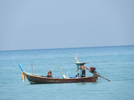 Fishing boats on the sandy beach at Khao Lak